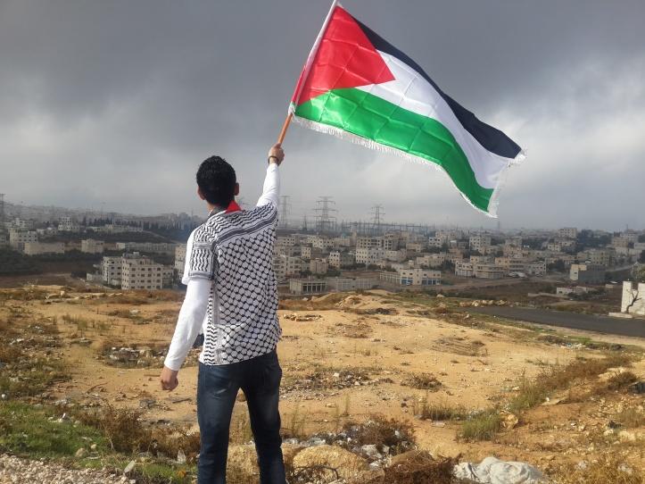 Man waving Jordanian flag