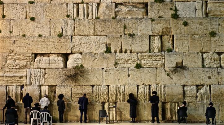 Men standing at wailing wall